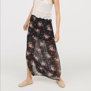New floral long skirt with slit at the sides.